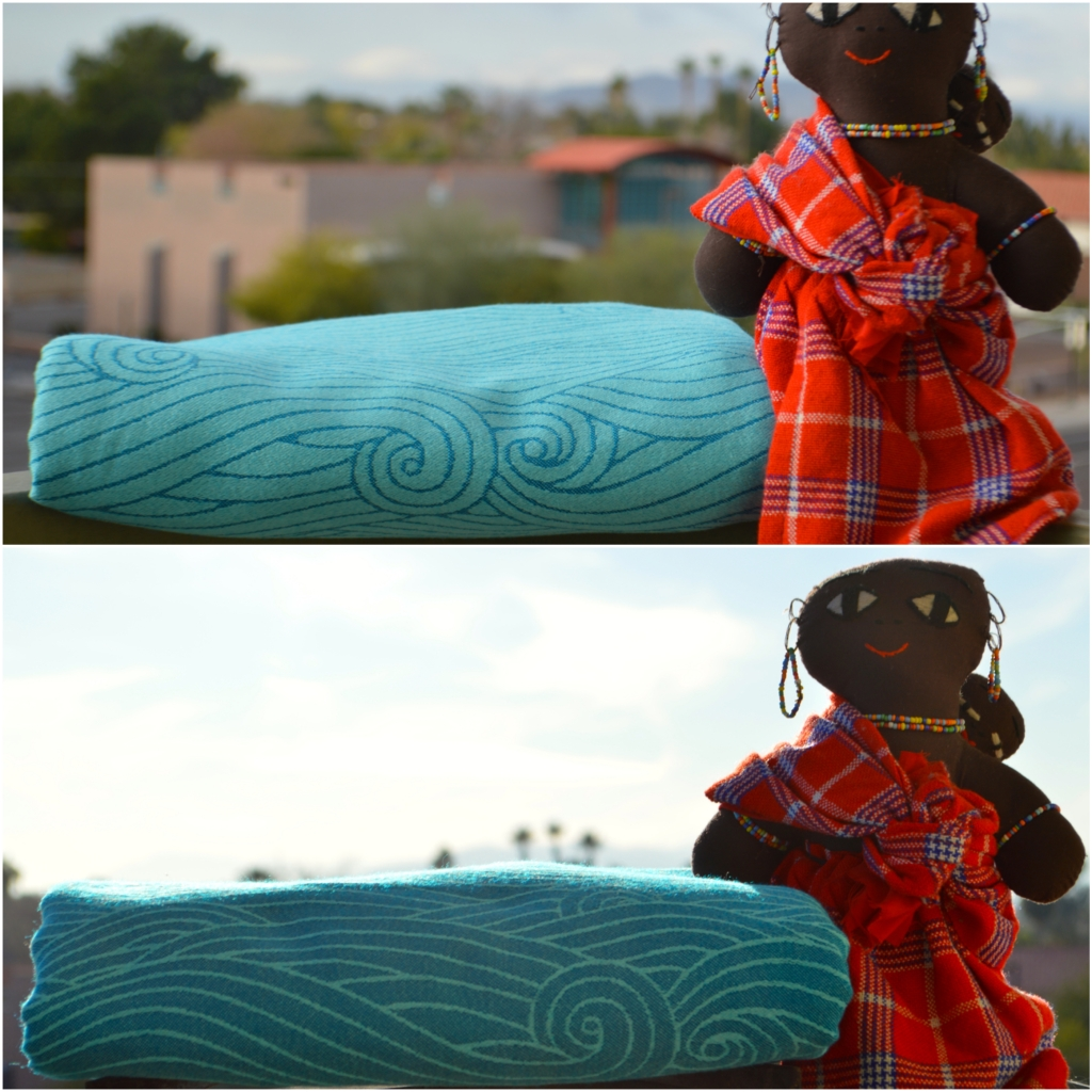The image is a collage of two images. The top image shows the turquoise blue and pale blue wrap with ocean swirls next to an African babywearing doll wearing Masai mara red flannel clothing. The wrap is approximately one inch below the dolls arm. The lower image is the same wrap after washing which has now fluffed up to touch the arm of the same doll.