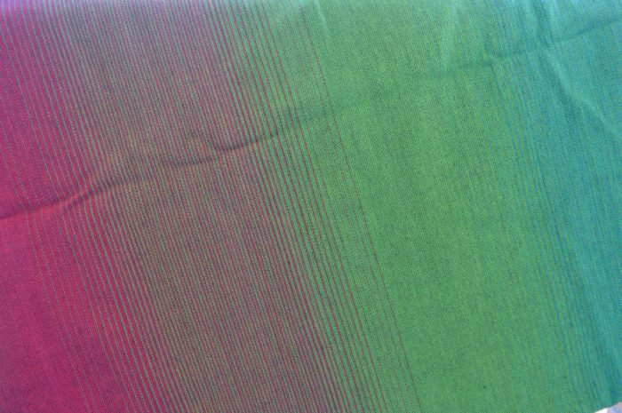 Up close image of a color graduation wrap from pink to magenta, vibrant green, into an azure blue