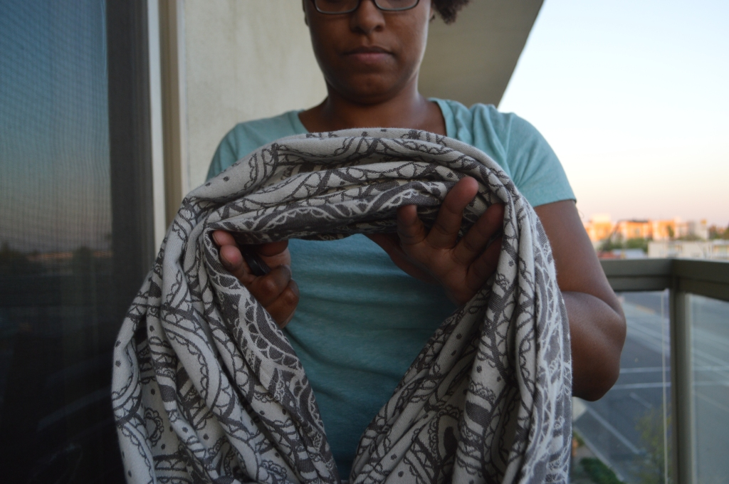 The woman is seen holding the loops over both hands